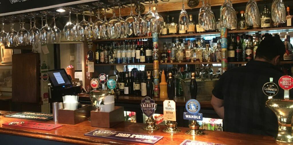 Kobas Till behind a pub bar