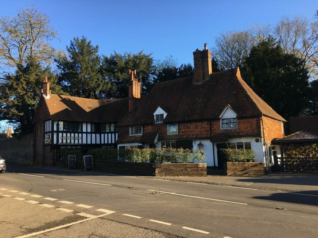 A roadside country pub on a bright, autumnal morning with a clear blue sky above